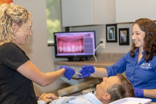 Dr Elizabeth Treating a patient at Dr Felts Office Chattanooga TN