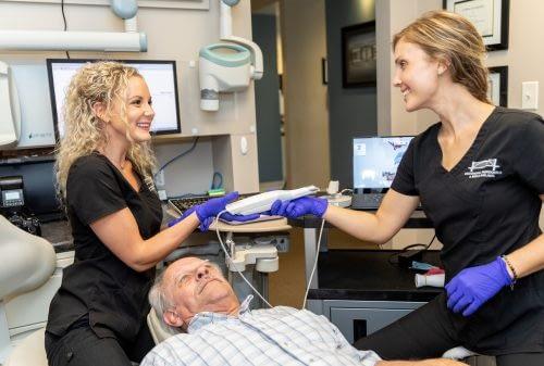 Dr Felts caring for a patient oral health DR. Elizabeth Felts Chattanooga TN