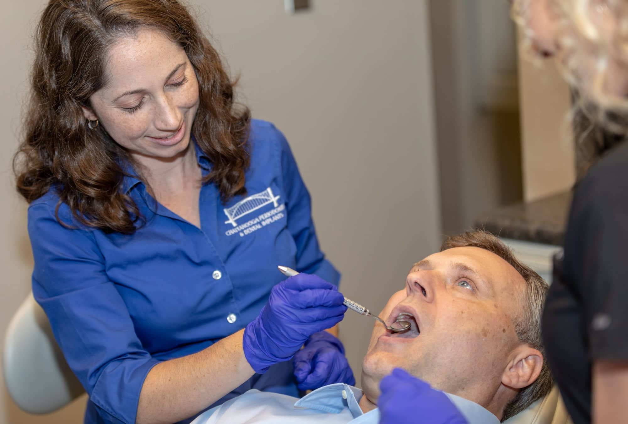Dr Elizabeth examining a patient at Dr Felts Office Chattanooga TN